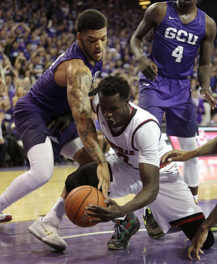 Grand Canyon forward Keonta Vernon, left, and Louisville forward Mangok Mathiang battle for the loose ball during the first half of an NCAA college basketball game Saturday, Dec. 3, 2016, in Phoenix. (AP Photo/Rick Scuteri)