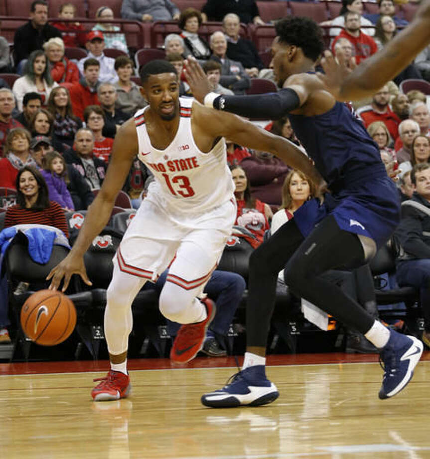 Ohio State's JaQuan Lyle, left, drives the baseline against Fairleigh Dickinson's Kaleb Bishop during the first half of an NCAA college basketball game Saturday, Dec. 3, 2016, in Columbus, Ohio. (AP Photo/Jay LaPrete)