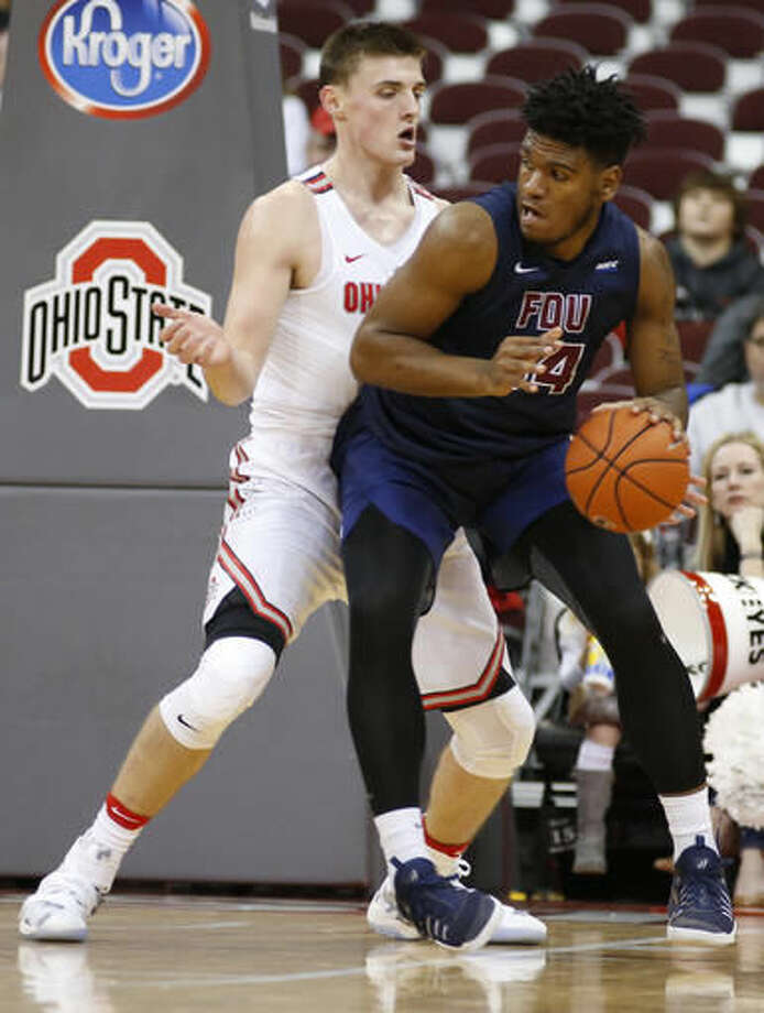 Fairleigh Dickinson's Mike Holloway, right, posts up against Ohio State's Micah Potter during the first half of an NCAA college basketball game Saturday, Dec. 3, 2016, in Columbus, Ohio. (AP Photo/Jay LaPrete)