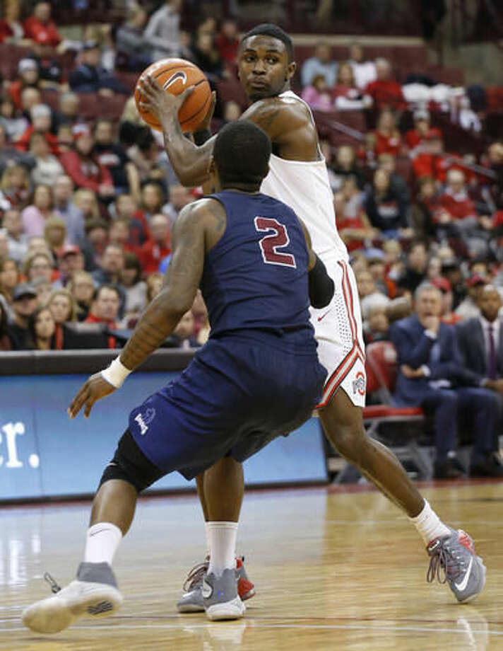 Ohio State's Kam Williams, top, looks for an open pass as Fairleigh Dickinson's Darian Anderson defends during the second half of an NCAA college basketball game Saturday, Dec. 3, 2016, in Columbus, Ohio. (AP Photo/Jay LaPrete)