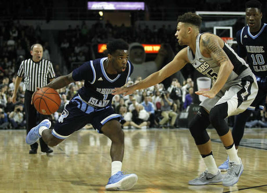 Rhode Island's Jarvis Garrett (1) is defended by Providence's Drew Edwards (25) during the first half of an NCAA college basketball game Saturday, Dec. 3, 2016, in Providence, R.I. (AP Photo/Stew Milne)