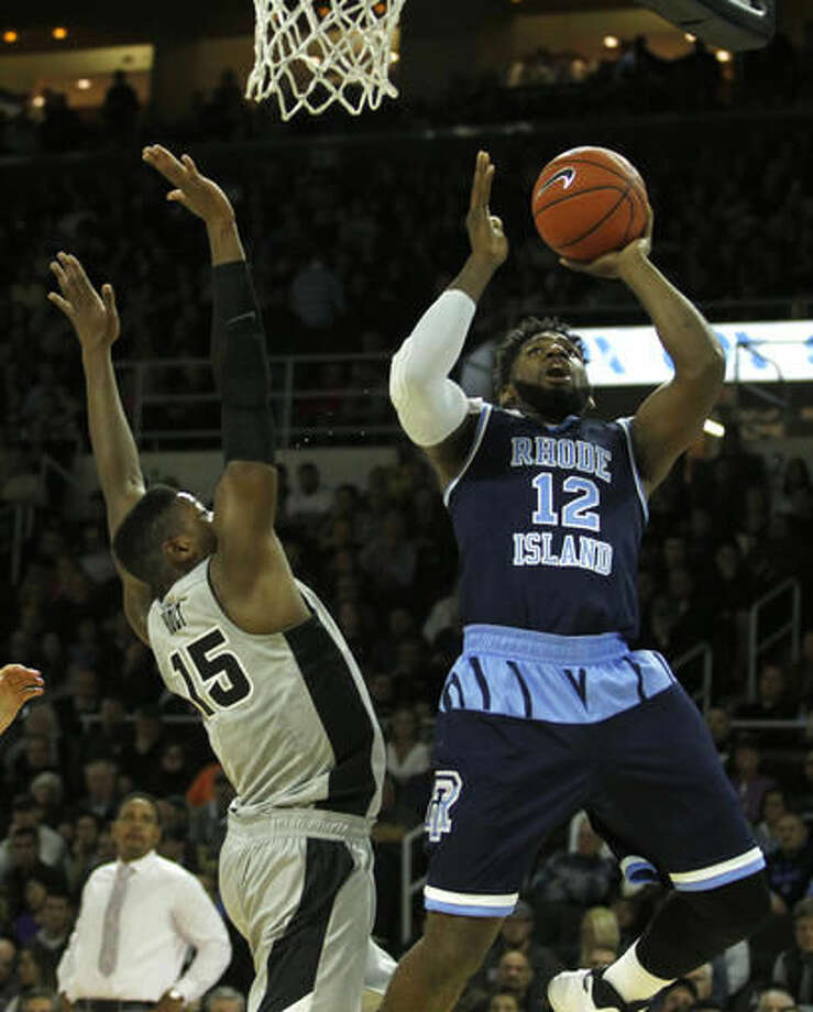 Rhode Island's Hassan Martin (12) shoots as Providence's Emmitt Holt (15) defends on the play during the first half of an NCAA college basketball game Saturday, Dec. 3, 2016, in Providence, R.I. (AP Photo/Stew Milne)