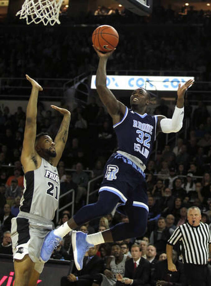 Rhode Island's Jared Terrell (32) makes a basket over the defense of Providence's Jalen Lindsey (21) during the first half of an NCAA college basketball game Saturday, Dec. 3, 2016, in Providence, R.I. (AP Photo/Stew Milne)