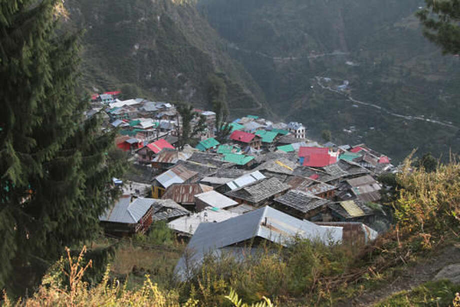 "This Tuesday Oct. 4, 2016 photo shows Malana village that stands in the higher reaches of the Indian Himalayas in the northern Indian state of Himachal Pradesh. Malana has become one of the world's top stoner destinations, and a symbolical battleground for India's fight against 'charas,' the black and sticky hashish that has made the village famous. While the rising demand and price of ""charas"" has benefited the villagers, it has also led to a slight increase in prosecutions and prompted the government to send machete-wielding police and forest personnel on long treks to destroy a small percentage of the marijuana fields. (AP Photo/Rishabh R. Jain)"