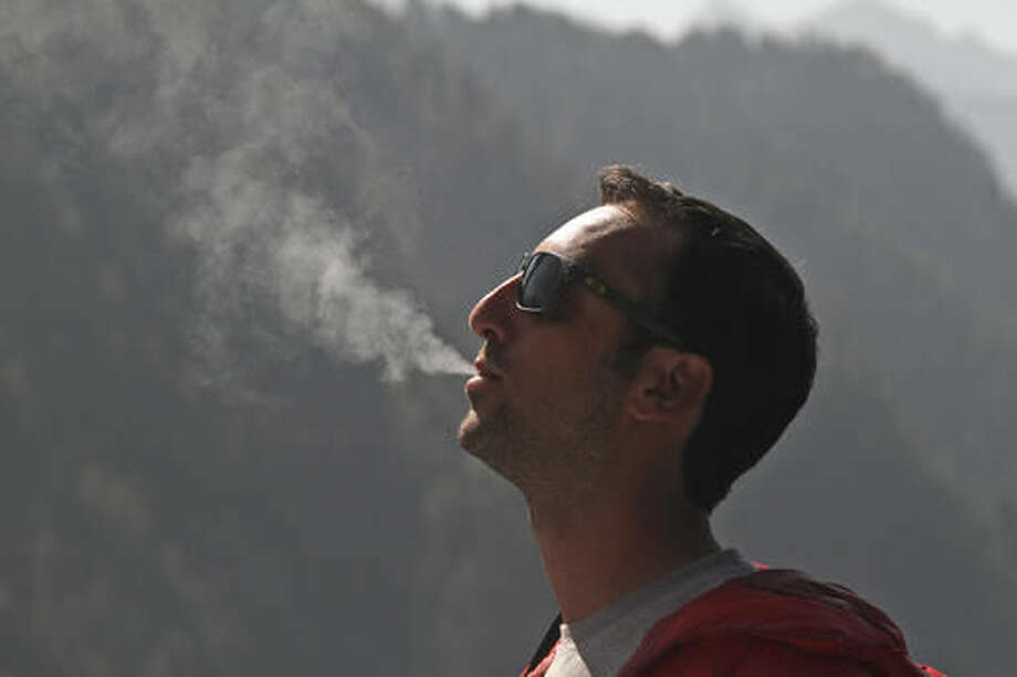 "In this Friday, Oct. 7, 2016 photo, French filmmaker Florent Dupont, 32, smokes a joint at a guesthouse in Malana village in the northern Indian state of Himachal Pradesh. ""It's just become a destination for international cool people, stoners, hikers,"" said Dupont, as he sipped tea and rolled a joint in a guesthouse. Nestled deep in the higher reaches of the Indian Himalayas, Malana has become one of the world's top stoner destinations, and a symbolical battleground for India's fight against 'charas,' the black and sticky hashish that has made the village famous. (AP Photo/Rishabh R. Jain)"