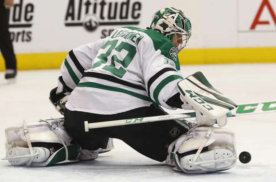 Dallas Stars goalie Kari Lehtonen, of Finland, makes a kick save of a Colorado Avalanche shot during the first period of an NHL hockey game Saturday, Dec. 3, 2016, in Denver. (AP Photo/David Zalubowski)