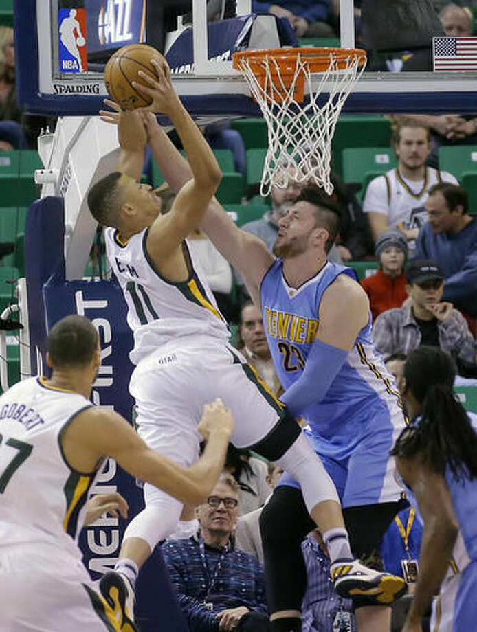 Denver Nuggets center Jusuf Nurkic (23) defends against Utah Jazz guard Dante Exum (11) during the first half of an NBA basketball game Saturday, Dec. 3, 2016, in Salt Lake City. (AP Photo/Rick Bowmer)