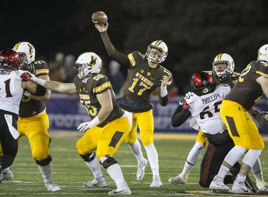 Wyoming's Josh Allen throws a pass against San Diego State during the first half of an NCAA college football game, Saturday, Dec. 3, 2016, in Laramie, Wyo. (AP Photo/Michael Smith)