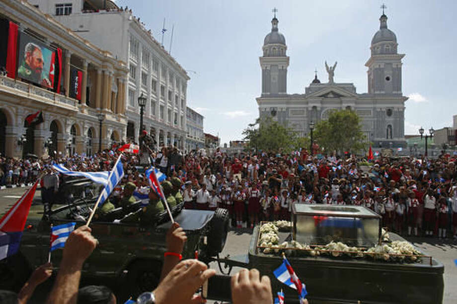 "People chant ""I am Fidel!"" as the motorcade carrying the ashes of the late Cuban leader Fidel Castro leaves Cespedes park in Santiago, Cuba, Saturday, Dec. 3, 2016. After days of national mourning and a tour of his ashes through the countryside, his remains have arrived to the city where they will be laid to rest. (AP Photo/Dario Lopez-Mills)"