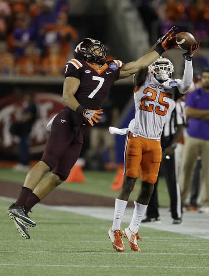 Clemson cornerback Cordrea Tankersley (25) catches a pass as Virginia Tech tight end Bucky Hodges (7) attempts to interfere, during the second half of the Atlantic Coast Conference championship NCAA college football game, Saturday, Dec. 3, 2016, in Orlando, Fla. (AP Photo/Chris O'Meara)