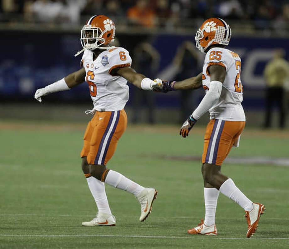 Clemson linebacker Dorian O'Daniel (6) is ejected from the game during the first half of the Atlantic Coast Conference championship NCAA college football game against Virginia Tech, Saturday, Dec. 3, 2016, in Orlando, Fla. To the right is Clemson tight end J.C. Chalk (25). (AP Photo/Chris O'Meara)