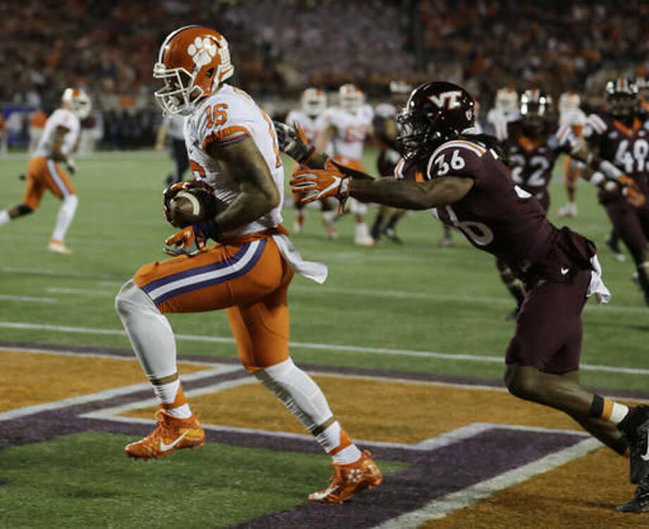 Clemson tight end Jordan Leggett (16) scores a touchdown as Virginia Tech cornerback Adonis Alexander (36) is late with the tackle, during the first half of the Atlantic Coast Conference championship NCAA college football game, Saturday, Dec. 3, 2016, in Orlando, Fla. (AP Photo/Chris O'Meara)
