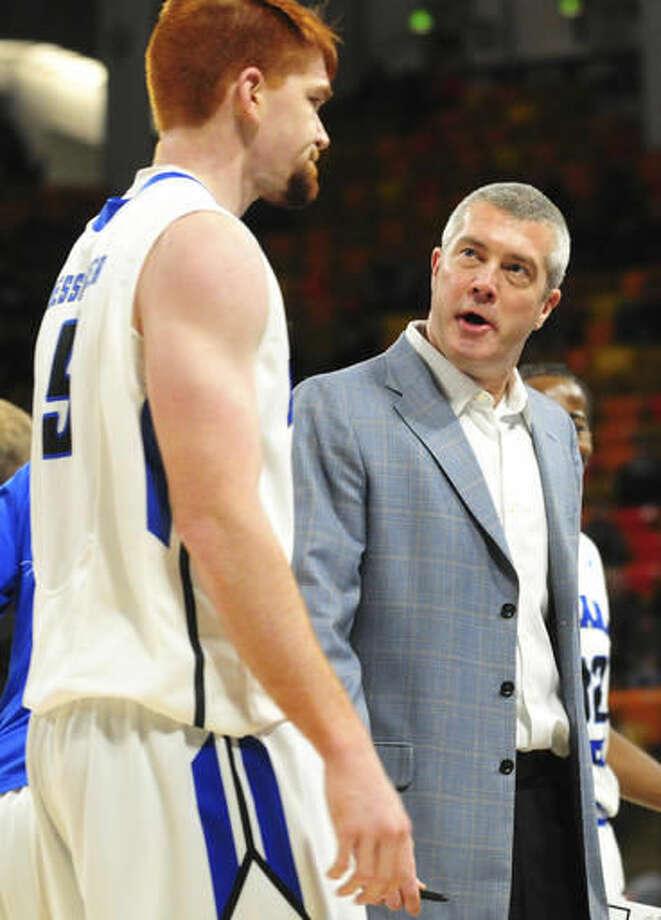 Indiana State coach Greg Lansing speaks to Bronson Kessinger during a timeout in an NCAA college basketball game against Utah State, Saturday, Dec. 3, 2016, in Logan, Utah. (John Zsiray/Herald Journal via AP)