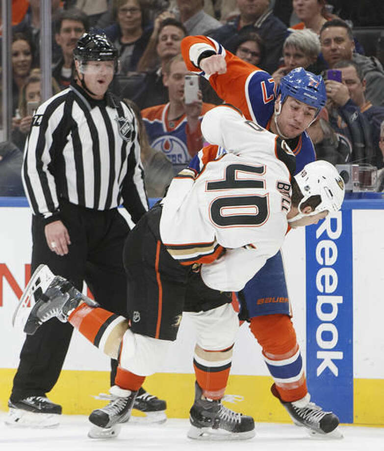 Anaheim Ducks' Jared Boll (40) and Edmonton Oilers' Milan Lucic (27) fight during the second period of an NHL hockey game Saturday, Dec. 3, 2016, in Edmonton, Alberta. (Jason Franson/The Canadian Press via AP)