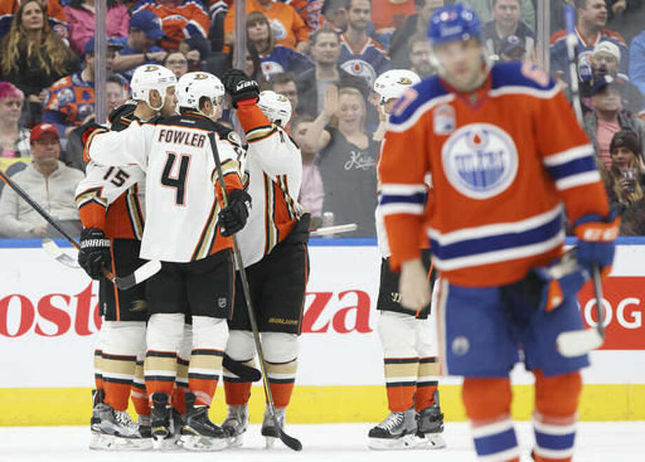 Anaheim Ducks celebrate a goal against the Edmonton Oilers during the second period of an NHL hockey game Saturday, Dec. 3, 2016, in Edmonton, Alberta. (Jason Franson/The Canadian Press via AP)