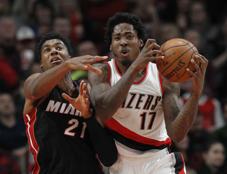 Miami Heat center Hassan Whiteside, left, and Portland Trail Blazers forward Ed Davis vie for a rebound during the first half of an NBA basketball game in Portland, Ore., Saturday, Dec. 3, 2016. (AP Photo/Steve Dipaola)
