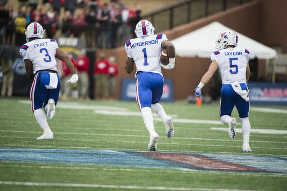 Louisiana Tech wide receiver Carlos Henderson (1) runs the ball in for a touchdown against Western Kentucky in the first half of the Conference USA championship NCAA college football game, Saturday, Dec. 3, 2016, at L.T. Smith Stadium in Bowling Green, Ky. (AP Photo/Michael Noble Jr.)