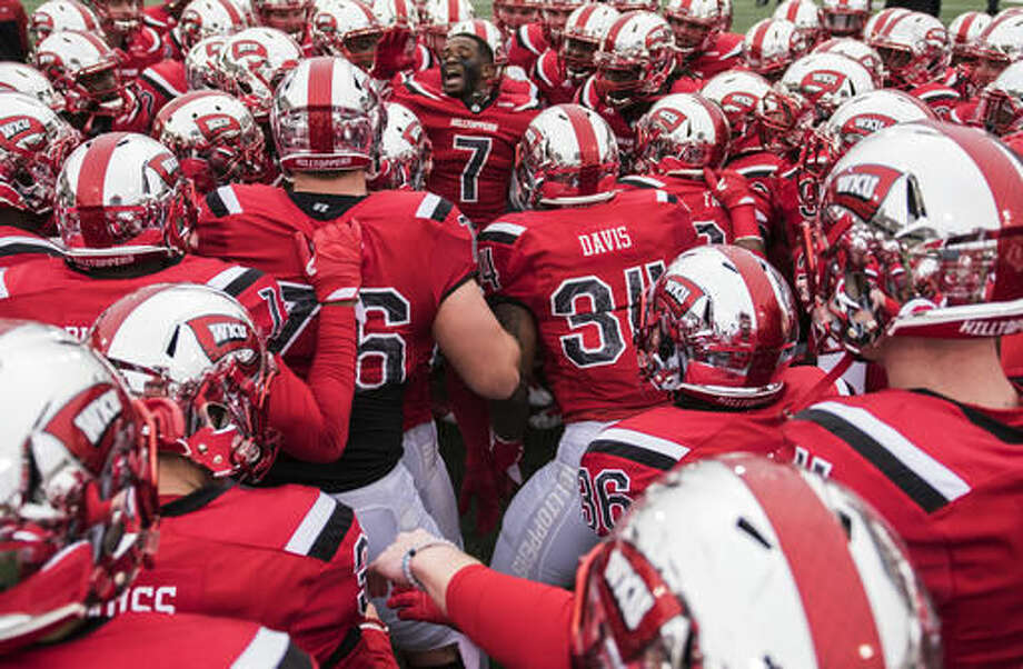 Western Kentucky defensive back Joe Brown (7) leads a chant with teammates before the Conference USA championship NCAA college football game against the Louisiana Tech, Saturday, Dec. 3, 2016 at L.T. Smith Stadium in Bowling Green, Ky. (AP Photo/Michael Noble Jr.)
