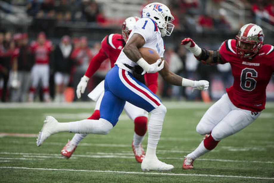 Louisiana Tech wide receiver Carlos Henderson (1) rung through the Western Kentucky defense in the first half of the Conference USA championship NCAA college football game, Saturday, Dec. 3, 2016, at L.T. Smith Stadium in Bowling Green, Ky. (AP Photo/Michael Noble Jr.)