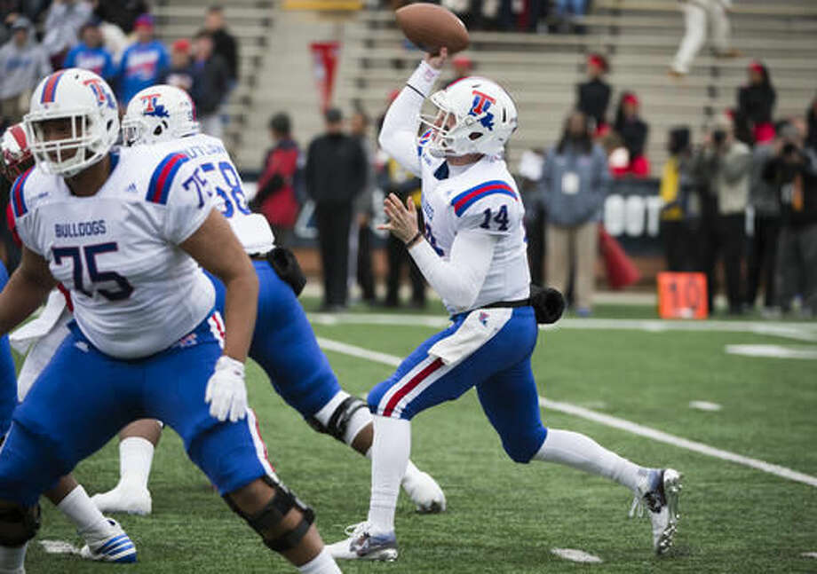 Louisiana Tech quarterback Ryan Higgins (14) makes a pass against Western Kentucky in the first half of the Conference USA championship NCAA college football game, Saturday, Dec. 3, 2016, at L.T. Smith Stadium in Bowling Green, Ky. (AP Photo/Michael Noble Jr.)