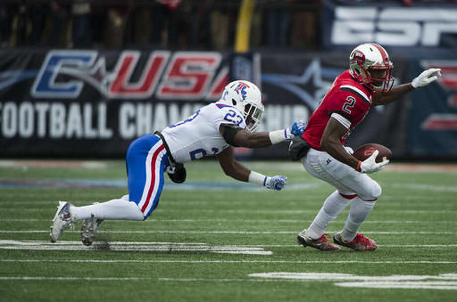 Western Kentucky wide receiver Taywan Taylor (2) attempts to break a tackle from Louisiana Tech cornerback Prince Sam (23) during the first half of the Conference USA championship NCAA college football game, Saturday, Dec. 3, 2016, at L.T. Smith Stadium in Bowling Green, Ky. (AP Photo/Michael Noble Jr.)