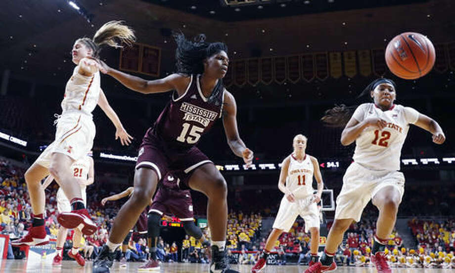 Mississippi State center Teaira McCowan (15) fights for a rebound with Iowa State guard Seanna Johnson (12) during the first half of an NCAA college basketball game, Saturday, Dec. 3, 2016, in Ames, Iowa. (AP Photo/Charlie Neibergall)
