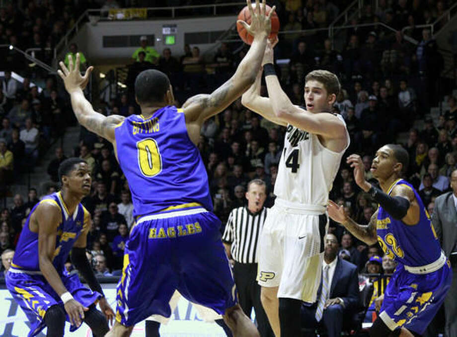 Purdue guard Ryan Cline passes the basketball defended by Morehead State guards Miguel Dicent, left, and Xavier Moon, right, and Morehead State forward Ty'Quan Bitting (0) in the second half of an NCAA college basketball game, Saturday, Dec. 3, 2016, in West Lafayette, Ind. Purdue won 90-56. (AP Photo/R Brent Smith)