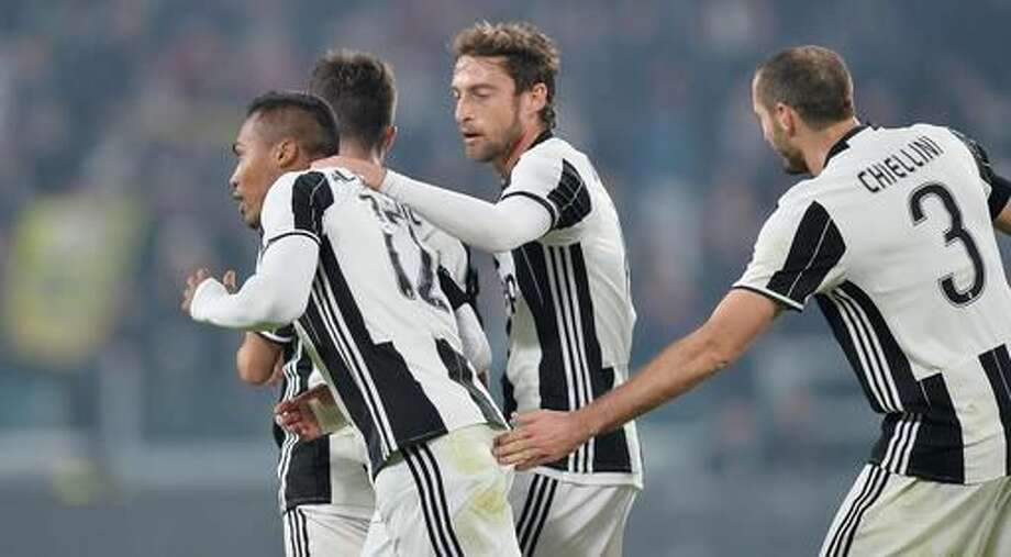 Juventus' Alex Sandro, left, celebrates with his teammates after scoring during a Serie A soccer match between Juventus and Atalanta, at the Juventus Stadium in Turin, Italy, Saturday, Dec. 3, 2016. (Alessandro Di Marco/ANSA via AP)