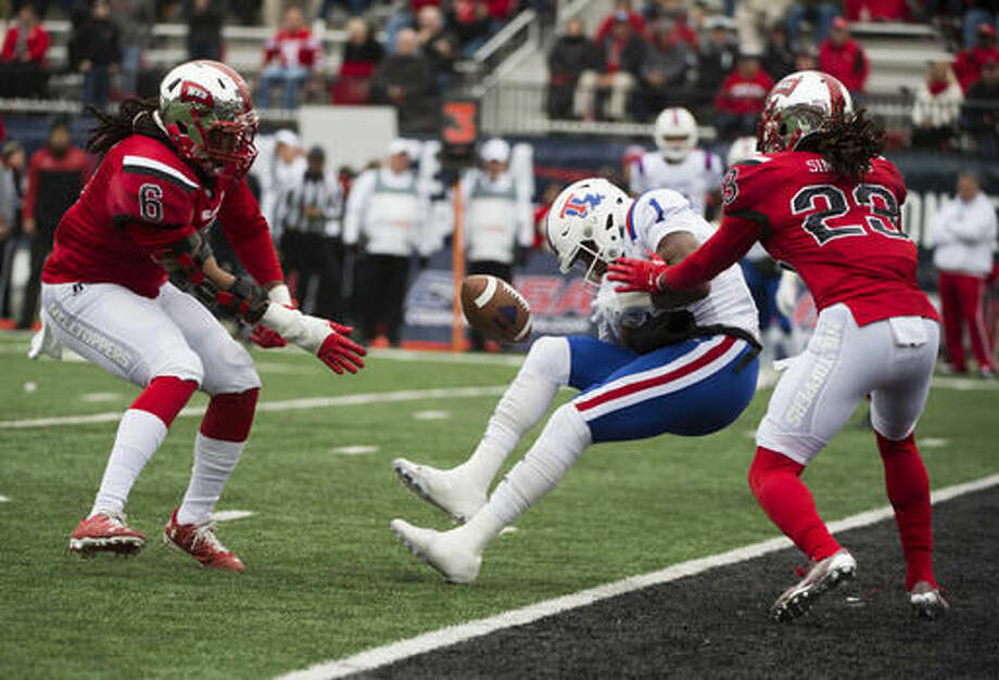 Western Kentucky linebacker T.J. McCollum (6) and defensive back De'Andre Simmons (23) force a incomplete pass on Louisiana Tech wide receiver Carlos Henderson (1) in the first half Conference USA championship NCAA college football game, Saturday, Dec. 3, 2016, at L.T. Smith Stadium in Bowling Green, Ky. (AP Photo/Michael Noble Jr.)