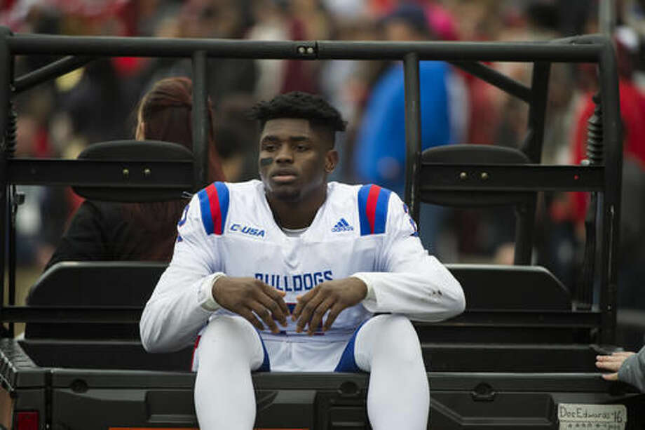 Louisiana Tech safety Secdrick Cooper (2) is carte off the field after running into a camera platform while playing Western Kentucky in the Conference USA championship NCAA college football game, Saturday, Dec. 3, 2016, at L.T. Smith Stadium in Bowling Green, Ky. (AP Photo/Michael Noble Jr.)