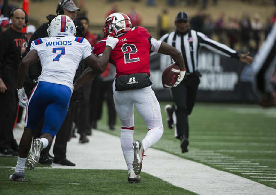 Louisiana Tech safety Xavier Woods (7) pulls Western Kentucky wide receiver Taywan Taylor (2) out of bounds during the first half of the Conference USA championship NCAA college football game, Saturday, Dec. 3, 2016, at L.T. Smith Stadium in Bowling Green, Ky. (AP Photo/Michael Noble Jr.)