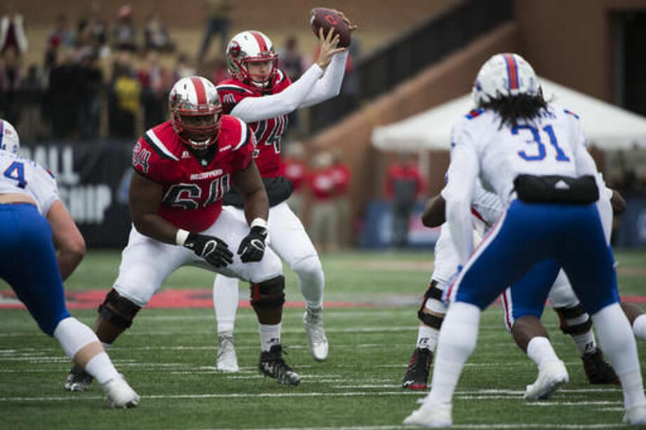 Western Kentucky quarterback Mike White (14) field a high snap during the first half of the Conference USA championship NCAA college football game against Louisiana Tech, Saturday, Dec. 3, 2016, at L.T. Smith Stadium in Bowling Green, Ky. (AP Photo/Michael Noble Jr.)
