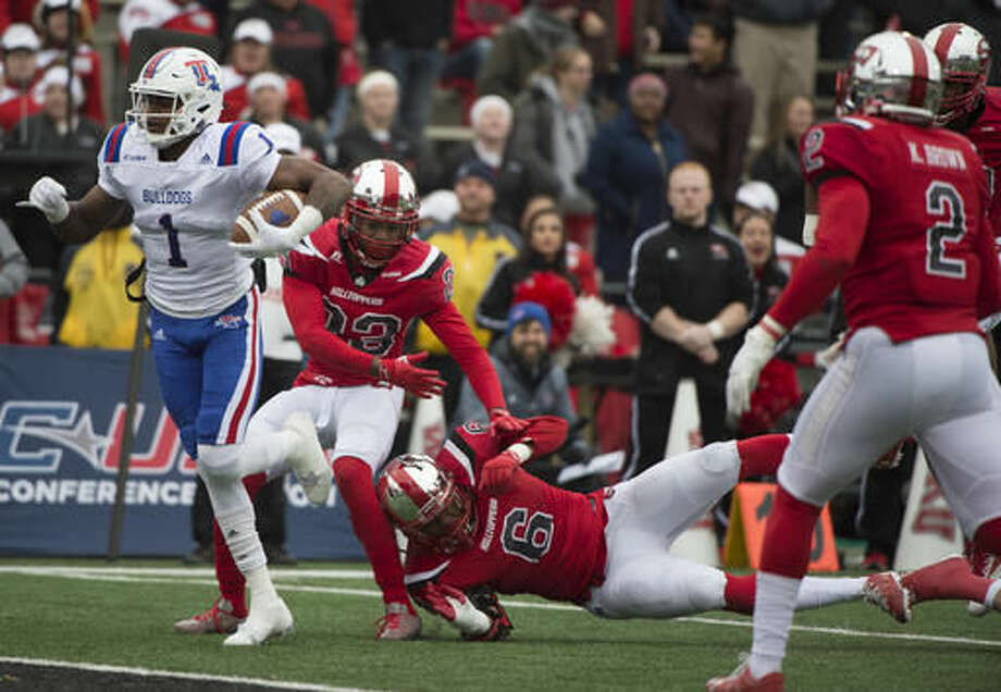 Louisiana Tech wide receiver Carlos Henderson (1) pushes through the Western Kentucky defense to score in the first half of the Conference USA championship NCAA college football game, Saturday, Dec. 3, 2016, at L.T. Smith Stadium in Bowling Green, Ky. (AP Photo/Michael Noble Jr.)