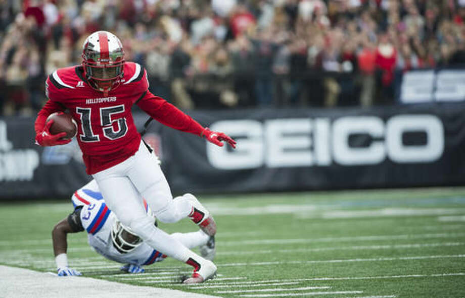 Western Kentucky wide receiver Nicholas Norris (15) makes a catch before falling out of bounds in the first half of the Conference USA championship NCAA college football game against Louisiana Tech, Saturday, Dec. 3, 2016, at L.T. Smith Stadium in Bowling Green, Ky. (AP Photo/Michael Noble Jr.)