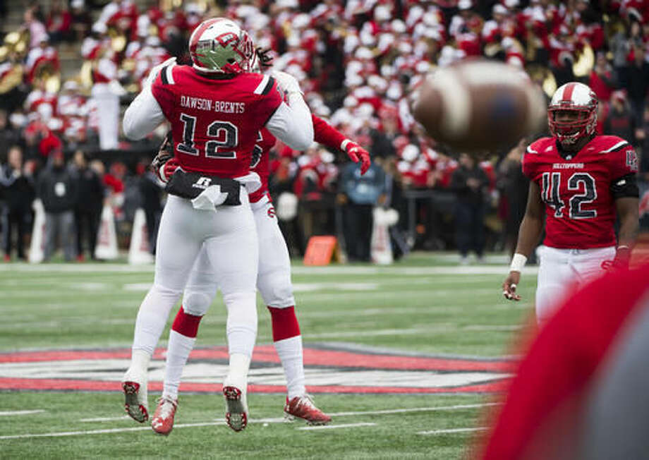 Western Kentucky defensive lineman, Nick Dawson-Brents celebrates with a teammate after a play against Louisiana Tech in the first half of the Conference USA championship NCAA college football game, Saturday, Dec. 3, 2016, at L.T. Smith Stadium in Bowling Green, Ky. (AP Photo/Michael Noble Jr.)