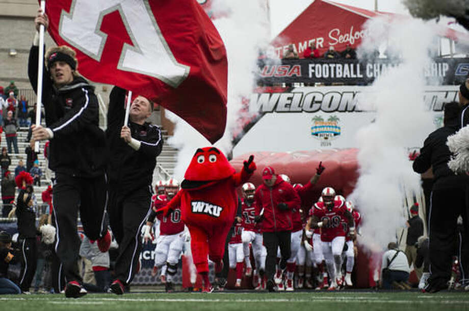 Western Kentucky mascot Big Red leads the team out on the field before the Conference USA championship NCAA college football game against Louisiana Tech, Saturday, Dec. 3, 2016, at L.T. Smith Stadium in Bowling Green, Ky. (AP Photo/Michael Noble Jr.)
