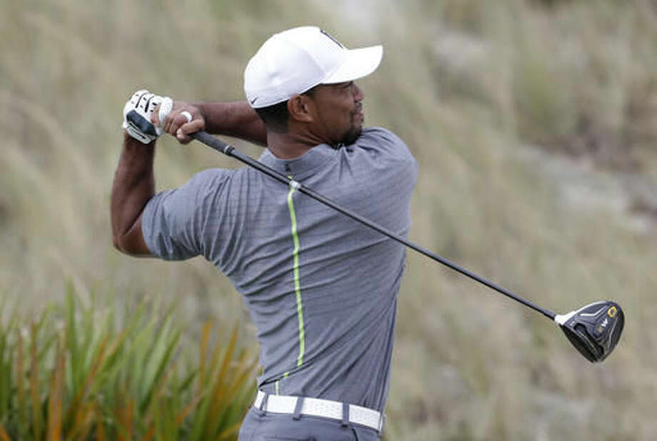 Tiger Woods watches his shot from he third tee during the third round at the Hero World Challenge golf tournament, Saturday, Dec. 3, 2016, in Nassau, Bahamas. (AP Photo/Lynne Sladky)