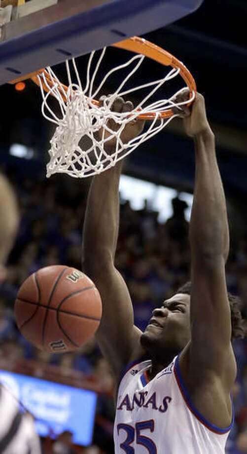 Kansas' Udoka Azubuike dunks the ball during the first half of an NCAA college basketball game against Stanford Saturday, Dec. 3, 2016, in Lawrence, Kan. (AP Photo/Charlie Riedel)