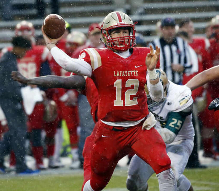 Lafayette quarterback William Ard (12) passes against Poplarville during the first half of the MHSAA Class 4A football championship game, in Starkville, Miss., Saturday, Dec. 3, 2016. (AP Photo/Rogelio V. Solis)