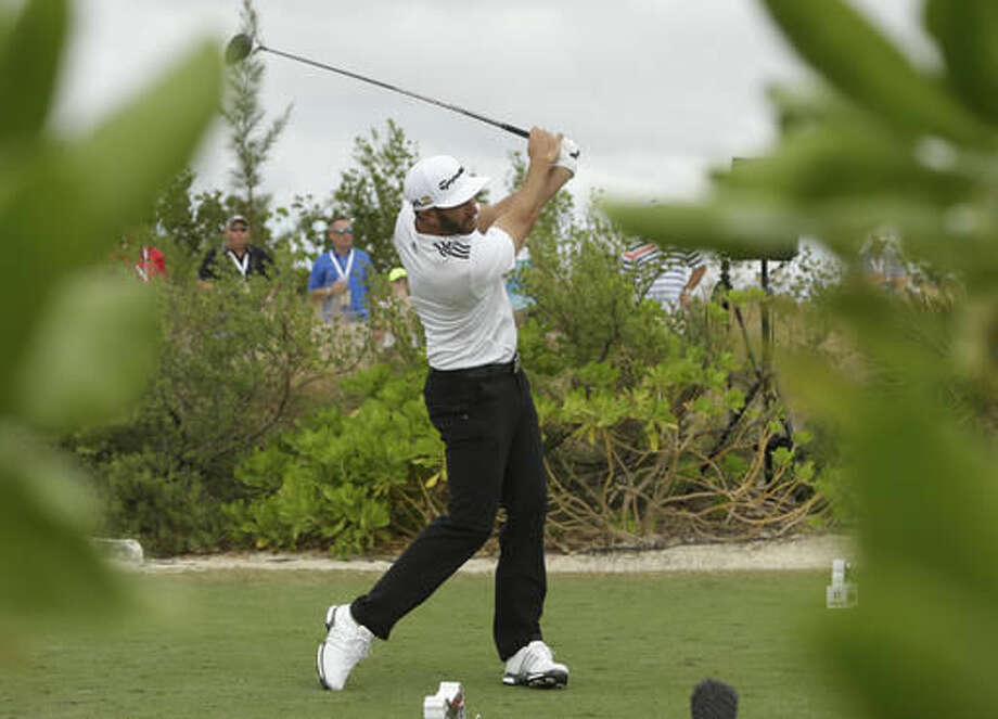 Dustin Johnson hits form the first hole during the third round at the Hero World Challenge golf tournament, Saturday, Dec. 3, 2016, in Nassau, Bahamas. (AP Photo/Lynne Sladky)