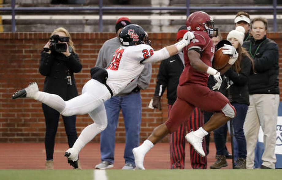 Knoxville Central linebacker Seth Armstrong (28) catches up to Memphis East running back Timothy Taylor, right, during the first half of the Division I Class 4A Tennessee high school football championship game Saturday, Dec. 3, 2016, in Cookeville, Tenn. (AP Photo/Mark Humphrey)