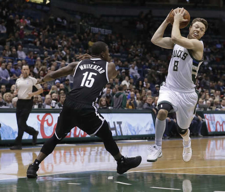 Milwaukee Bucks' Matthew Dellavedova drives past Isaiah Whitehead during the first half of an NBA basketball game Saturday, Dec. 3, 2016, in Milwaukee. (AP Photo/Morry Gash)