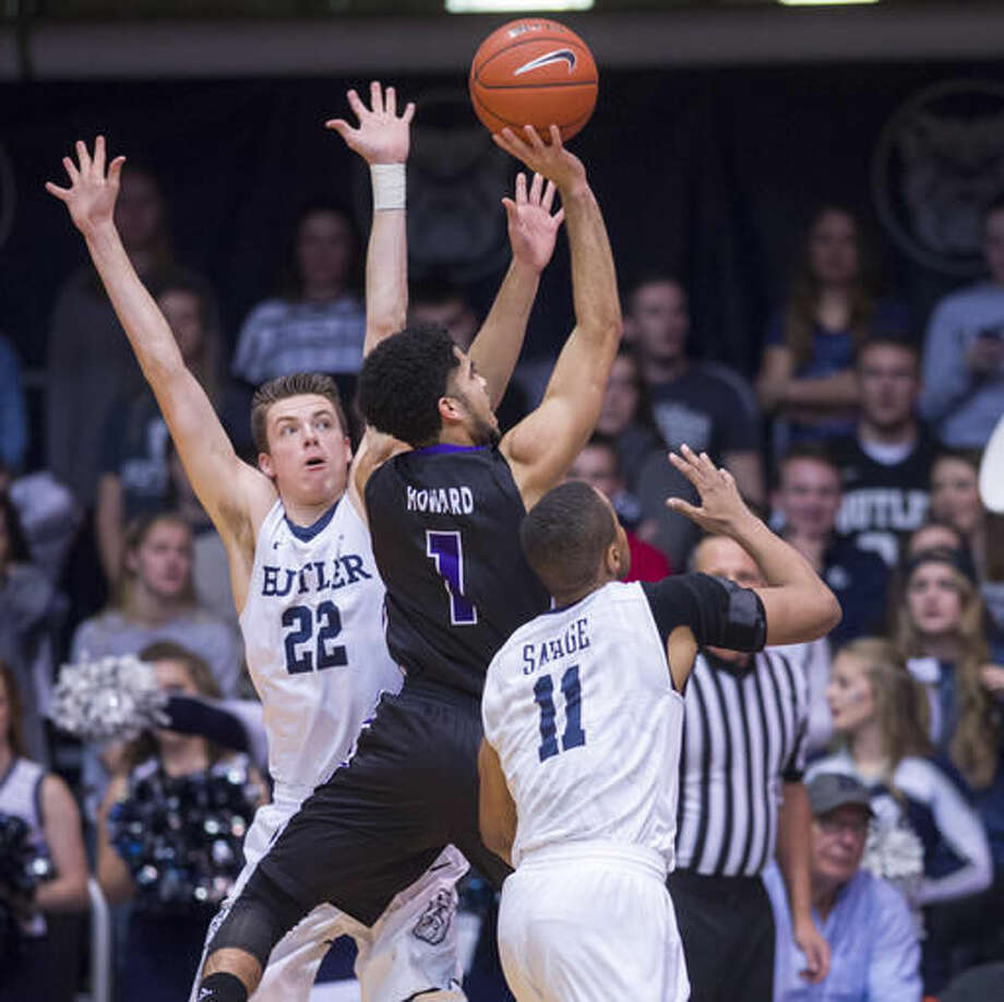 Central Arkansas guard Jordan Howard (1) slips through the defense of Butler guard Sean McDermott (22), left, and guard Kethan Savage (11) in the first half of an NCAA college basketball game in Indianapolis, Saturday, Dec. 3, 2016. (AP Photo/Doug McSchooler)