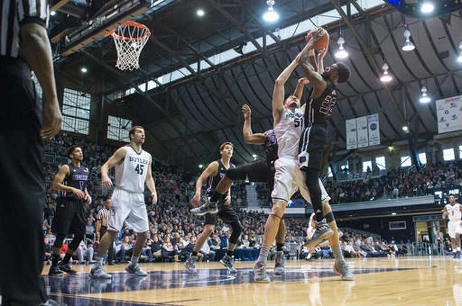 Central Arkansas guard Derreck Brooks (32) is stopped on his way to the basket by Butler forward Joey Brunk (50) in the first half of an NCAA college basketball game in Indianapolis, Saturday, Dec. 3, 2016. (AP Photo/Doug McSchooler)