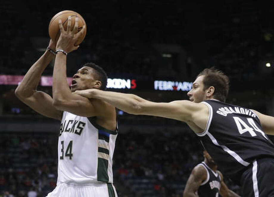 Brooklyn Nets' Bojan Bogdanovic fouls Milwaukee Bucks' Giannis Antetokounmpo during the first half of an NBA basketball game Saturday, Dec. 3, 2016, in Milwaukee. (AP Photo/Morry Gash)