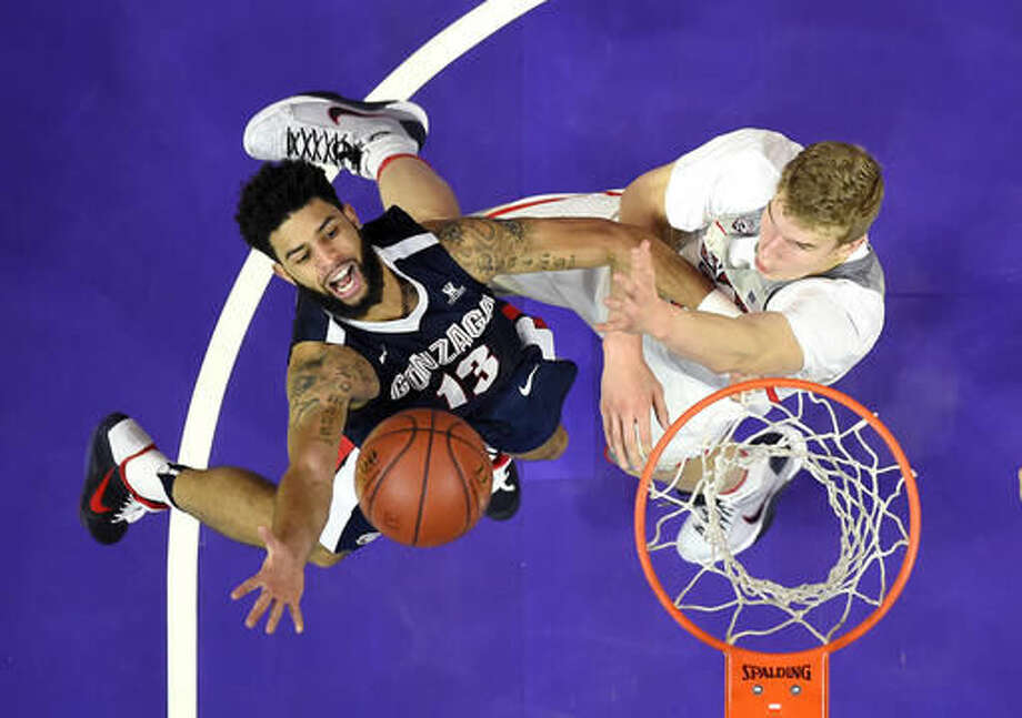 Gonzaga guard Josh Perkins, left, shoots as Arizona forward Lauri Markkanen defends during the first half of an NCAA college basketball game, Saturday, Dec. 3, 2016, in Los Angeles. (AP Photo/Mark J. Terrill)