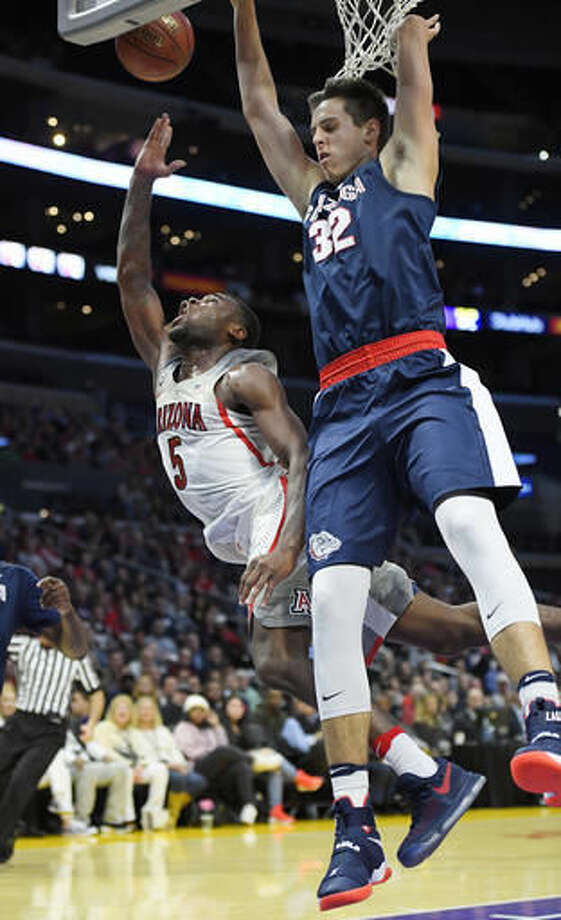 Arizona guard Kadeem Allen, left, shoots as Gonzaga forward Zach Collins defends during the first half of an NCAA college basketball game, Saturday, Dec. 3, 2016, in Los Angeles. (AP Photo/Mark J. Terrill)