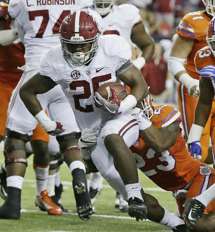 Alabama running back Joshua Jacobs (25) runs into the end zone for a touchdown as Florida defensive back Chauncey Gardner (23) defends during the first half of the Southeastern Conference championship NCAA college football game, Saturday, Dec. 3, 2016, in Atlanta.(AP Photo/Butch Dill)