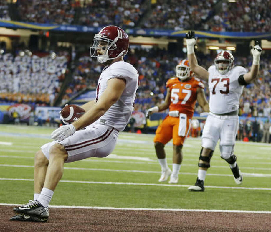 Alabama wide receiver Gehrig Dieter (11) runs into the end zone for a touchdown against Florida during the first half of the Southeastern Conference championship NCAA college football game, Saturday, Dec. 3, 2016, in Atlanta.(AP Photo/John Bazemore)