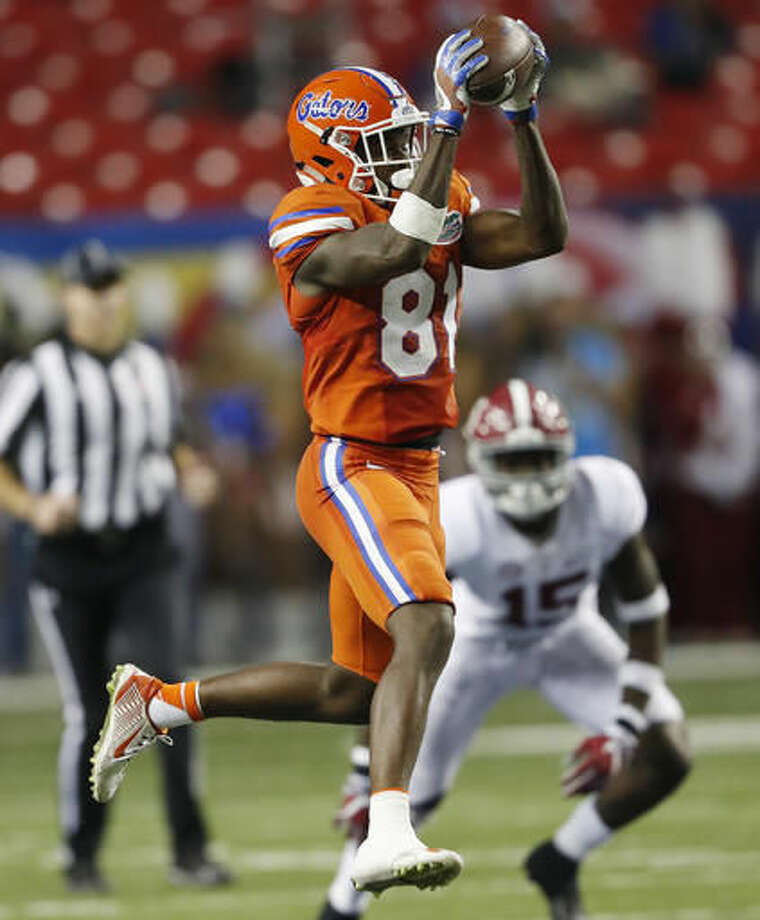 Florida wide receiver Antonio Callaway (81) makes the catch ahead of Alabama defensive back Ronnie Harrison (15) during the first half of the Southeastern Conference championship NCAA college football game, Saturday, Dec. 3, 2016, in Atlanta.(AP Photo/John Bazemore)